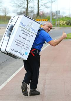 Enda O'Doherty carrying fridge