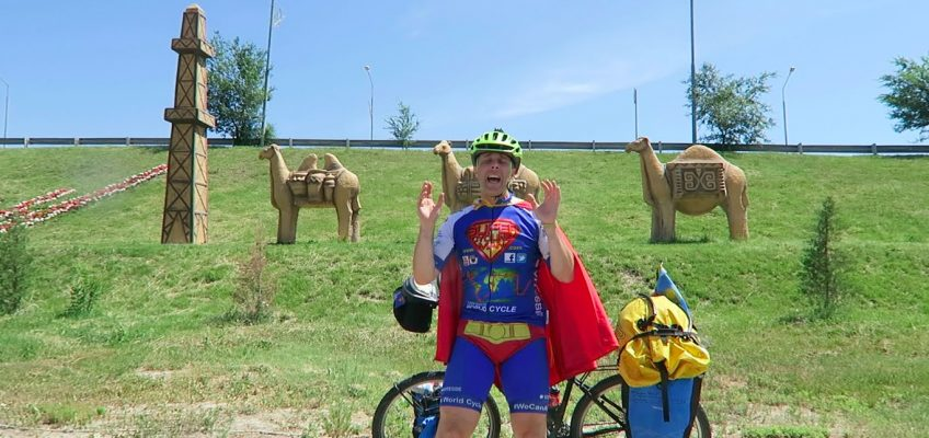 SuperCyclingMan cycling with camels in Kazakhstan
