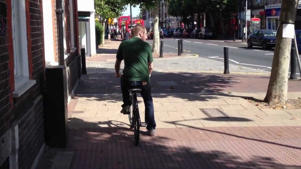 Cyclist cycles into wall
