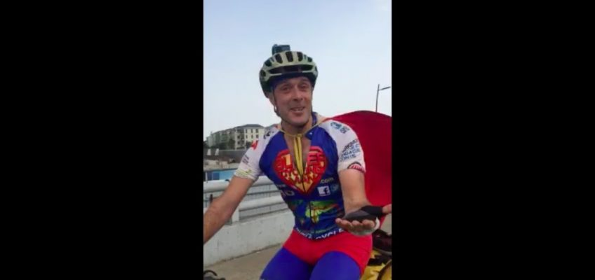 """""""So…why are you cycling around the world in a superhero costume?"""""""